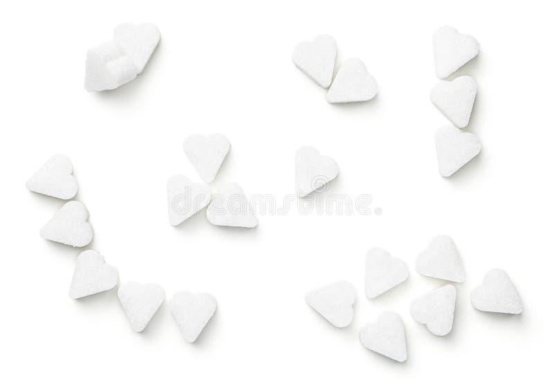糖在被隔绝的心脏形状求立方 免版税库存图片