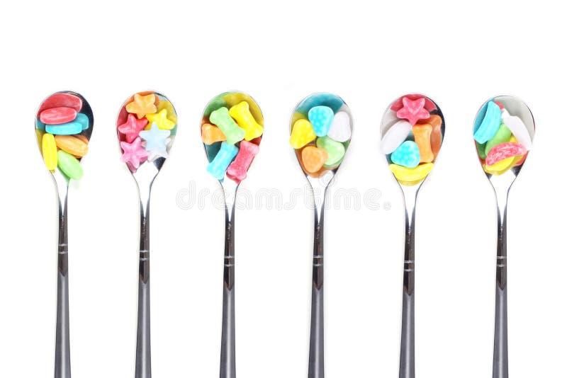 糖果五颜六色的金属匙子 库存照片