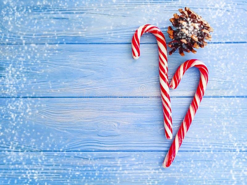 糖果,雪在木背景的爆沸xmas,圣诞节 库存照片