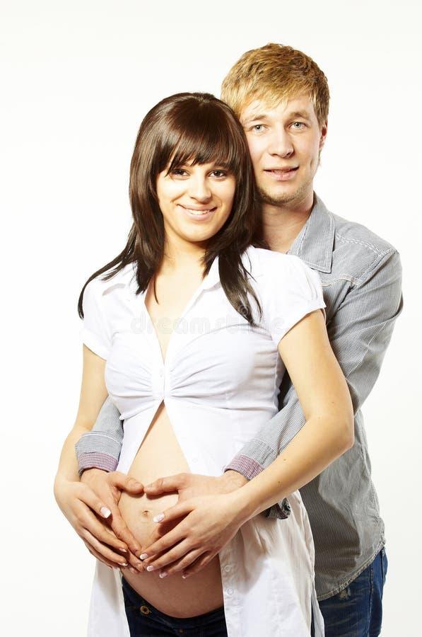 系列愉快的爱怀孕的年轻人 库存照片