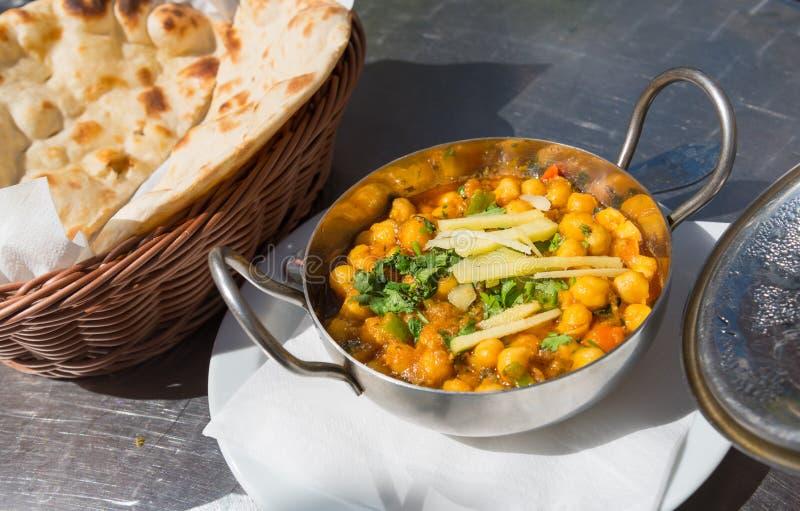 素食膳食chana masala,鸡豆咖喱,印地安盘 免版税库存照片