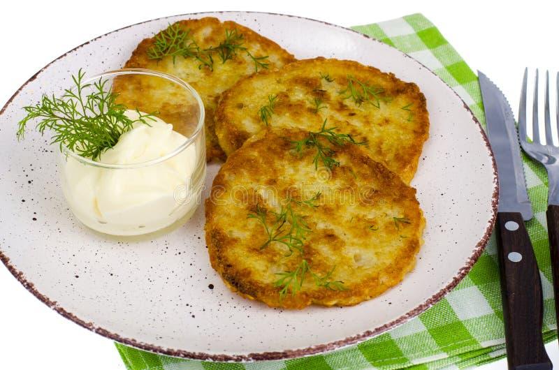 素食菜油煎的土豆薄烤饼用调味汁 免版税库存图片