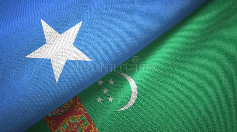 索马里和土库曼斯坦两旗子纺织品布料,织品纹理 免版税图库摄影