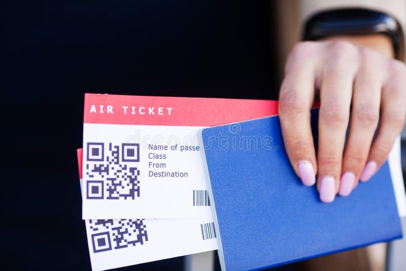 紧密两在海外护照的机票在机场附近 库存照片