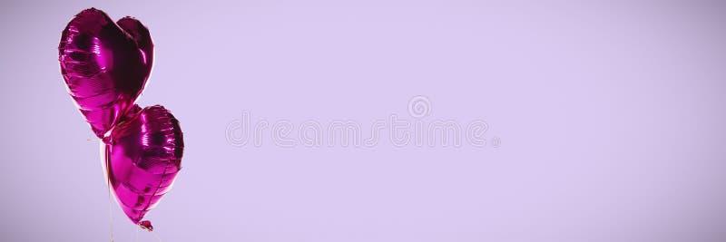 紫色心形气球的综合图象 免版税图库摄影