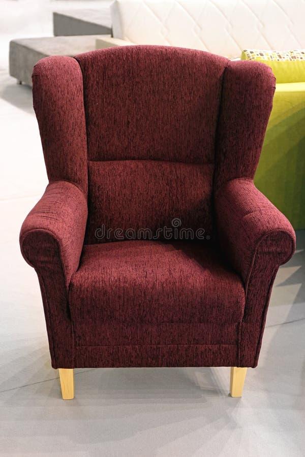 紫色扶手椅子 库存图片