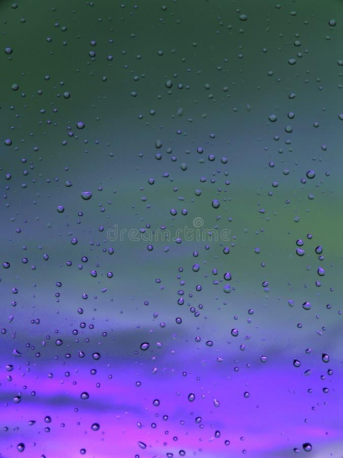 紫色抽象蓝色深刻的小滴 库存图片