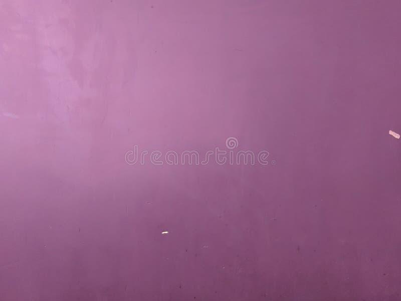 紫色油漆混凝土墙纹理背景 免版税库存照片
