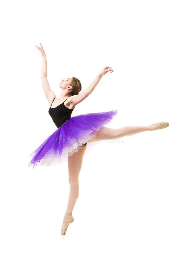 紫色芭蕾舞短裙和黑紧身连衣裤舞蹈芭蕾的女孩 库存图片