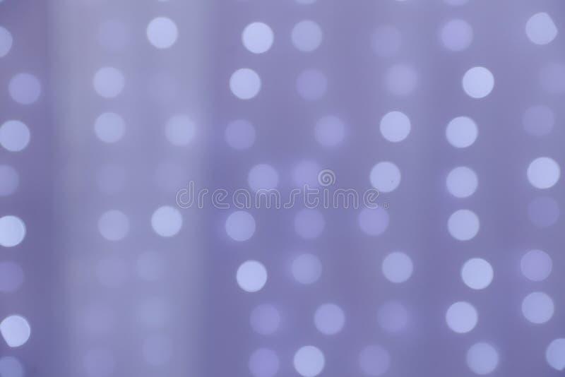 紫色bokeh背景摘要 免版税库存图片