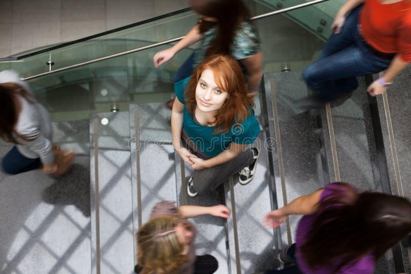 繁忙的下来冲的楼梯学员 图库摄影