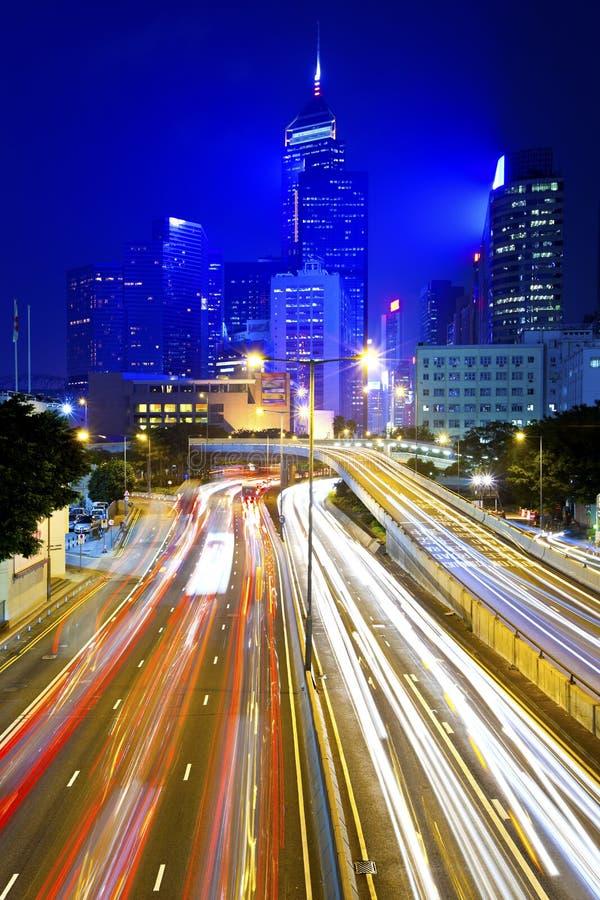 繁忙的业务量在晚上在香港 免版税库存照片