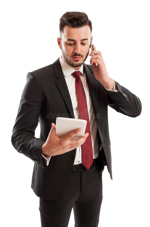 繁忙的商人多任务 免版税库存图片