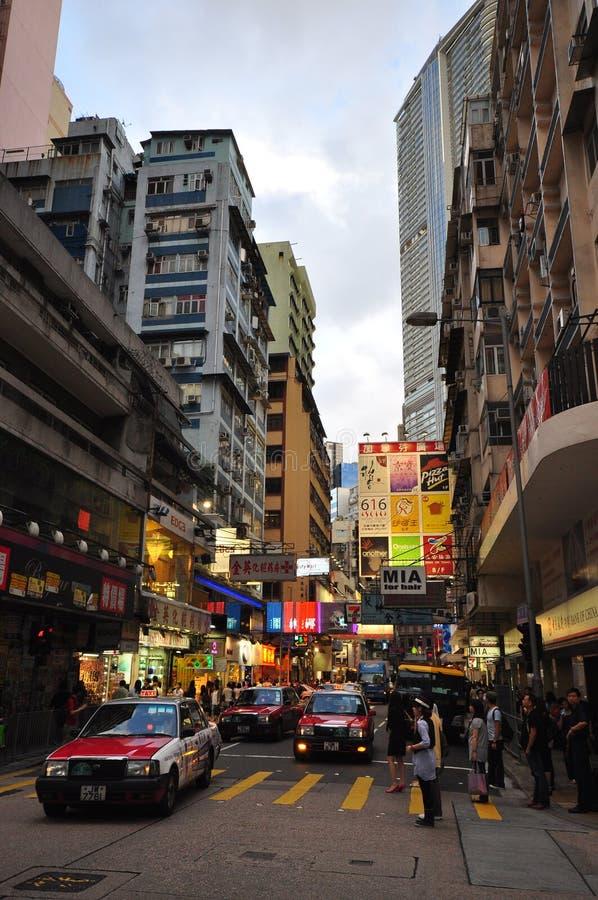 繁忙的香港场面街道出租汽车 免版税库存照片