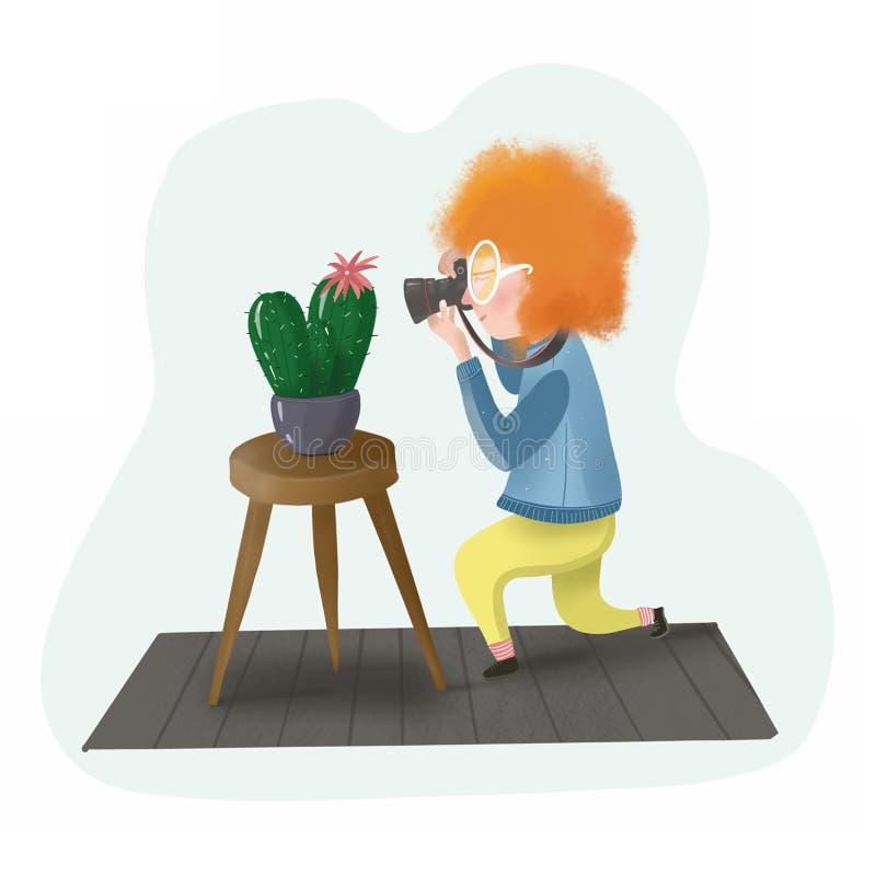 红发摄影师摄影师照片仙人掌 皇族释放例证