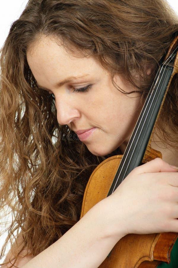 红头发人小提琴妇女 免版税库存图片