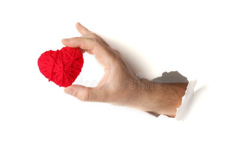 红心在手中在白色背景 爱和浪漫史的标志 图库摄影