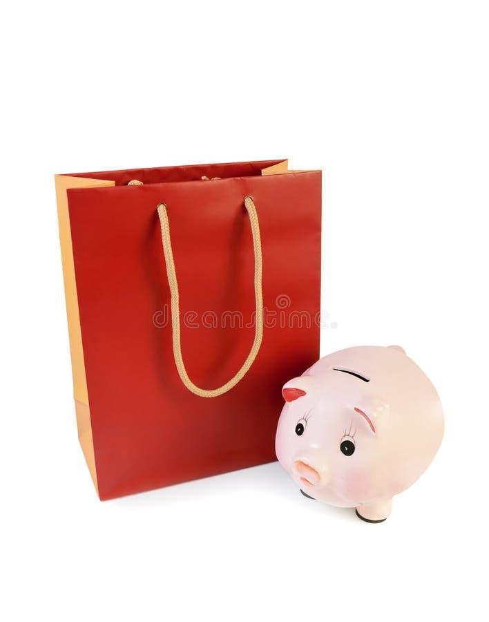 红橙色被隔绝的购物袋和存钱罐 库存照片
