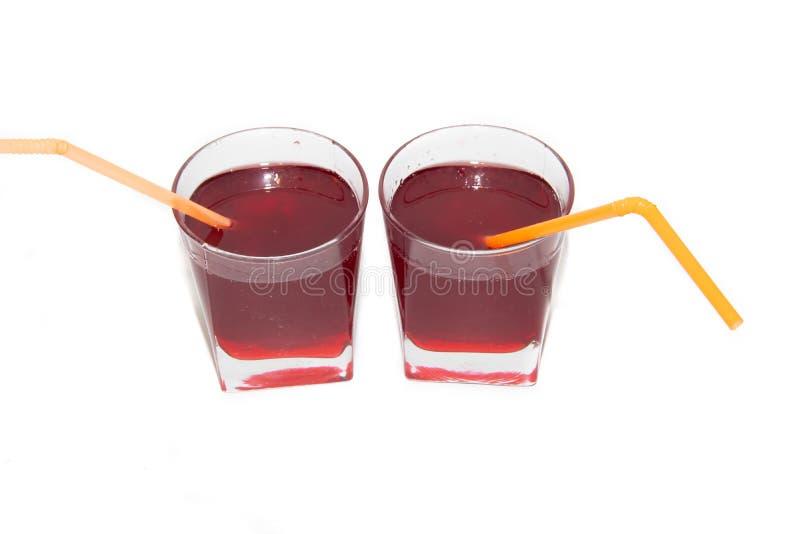 红浆果糖浆在玻璃的在白色背景 库存图片
