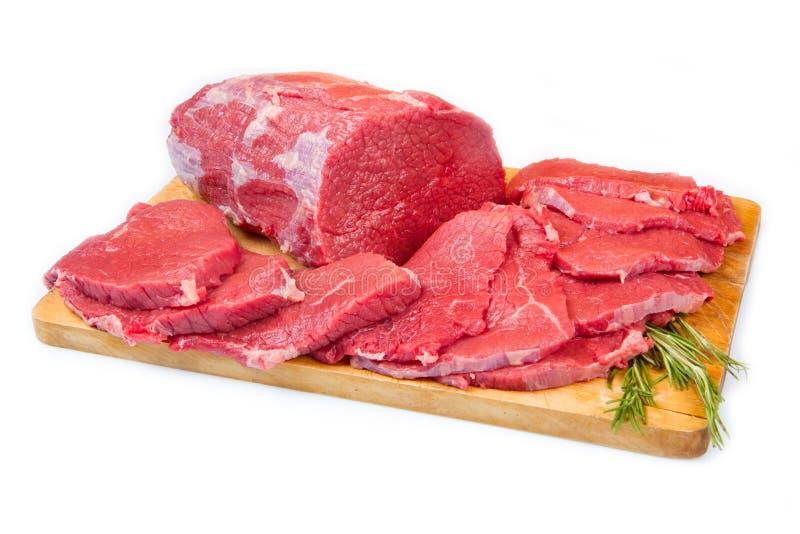 红肉大块和牛排被隔绝在木背景 库存照片