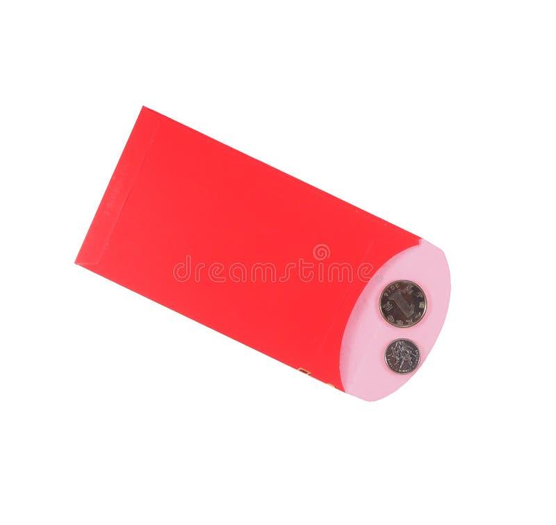 红色信封和硬币在白色背景 库存图片