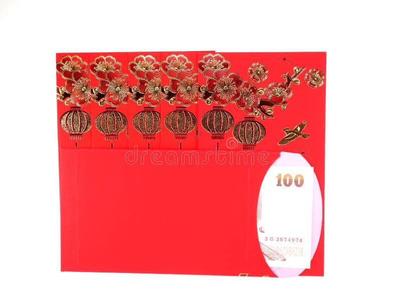 红色信封和金钱在白色背景 库存图片