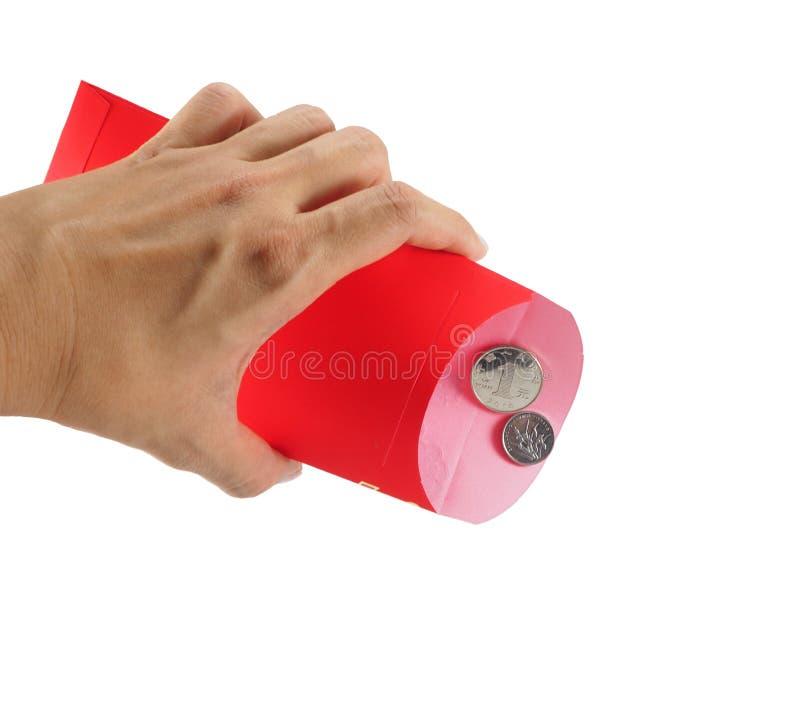 红色信封和金钱在白色背景 免版税图库摄影
