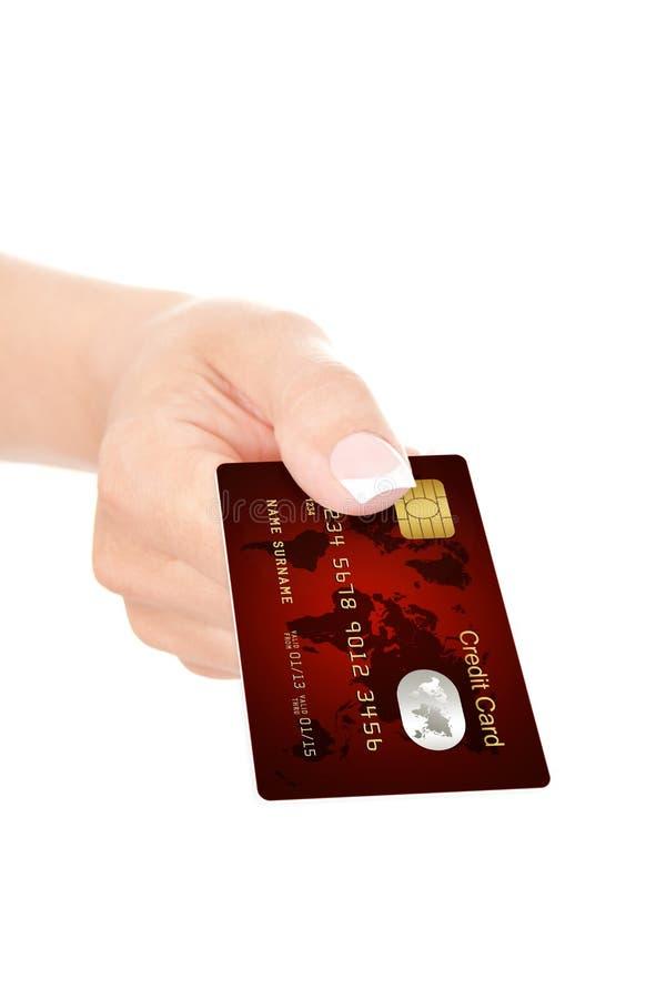 红色信用卡特写镜头用手holded在白色 免版税图库摄影