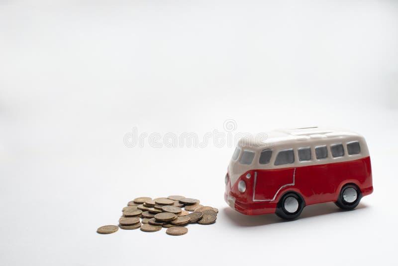 红色公共汽车moneybox 库存图片