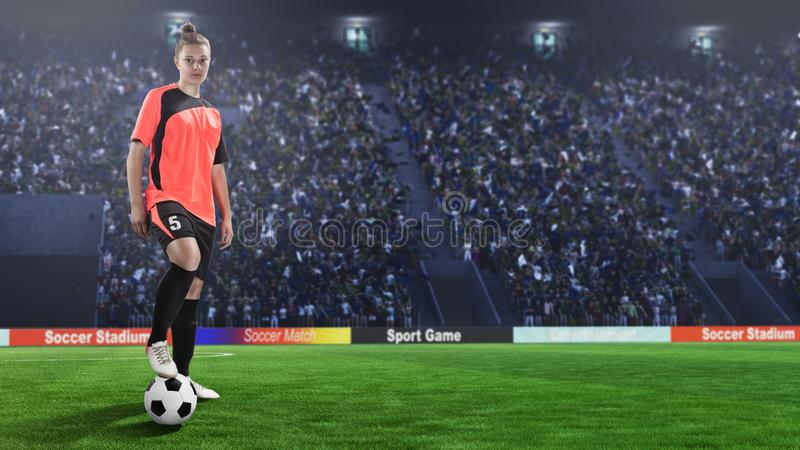 红色制服的女性足球运动员在足球场 免版税图库摄影