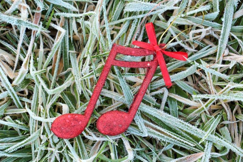 红色发光的装饰圣诞节音乐笔记 免版税库存照片