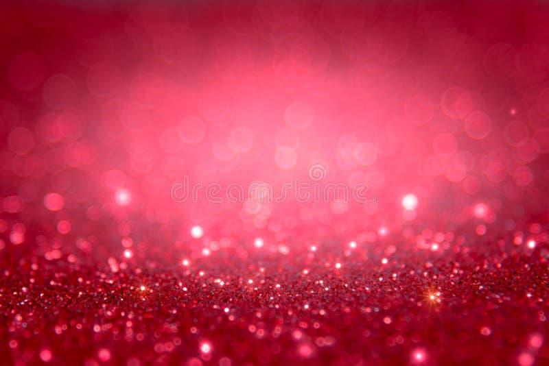红色和桃红色闪烁提取与bokeh defocused锂的背景 库存照片