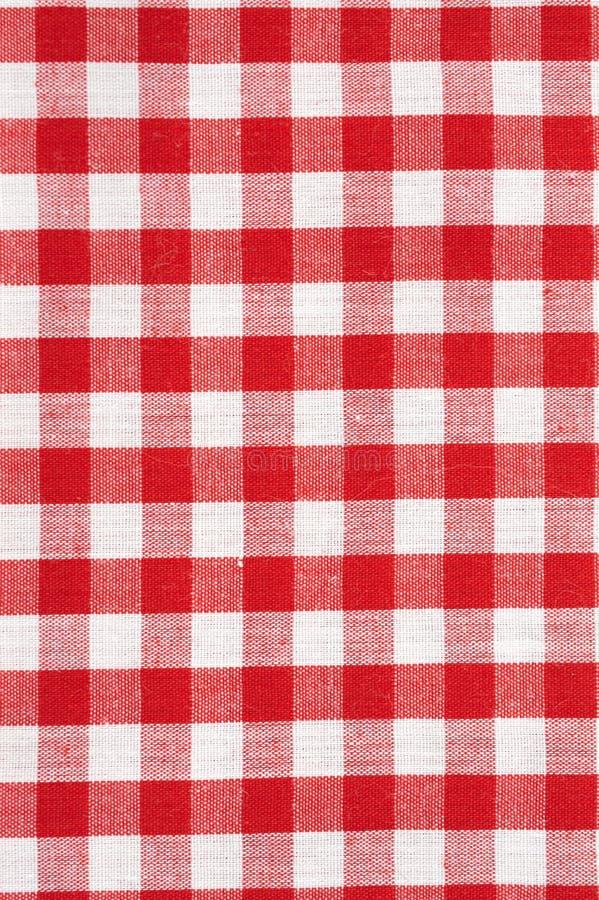 红色和白色方格的桌布背景 免版税库存图片