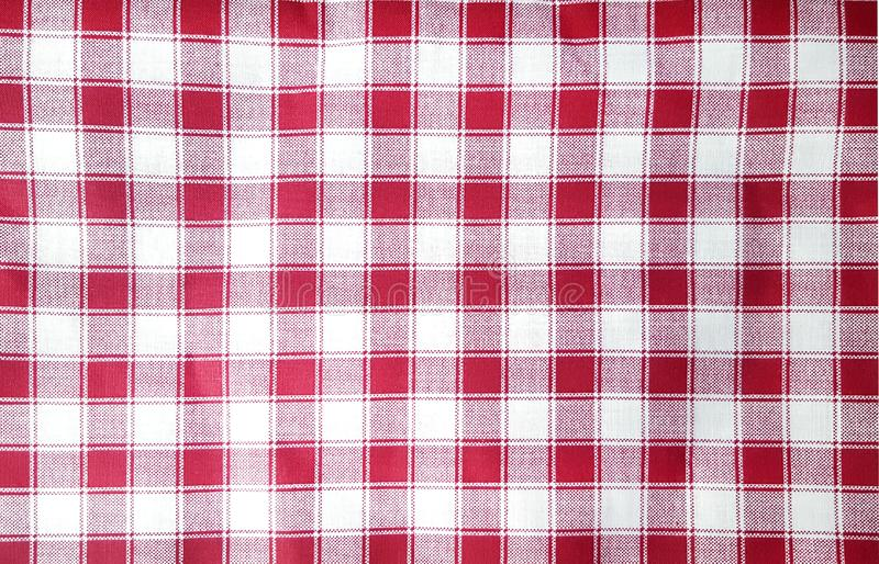 红色和白色方格花布桌布 库存图片