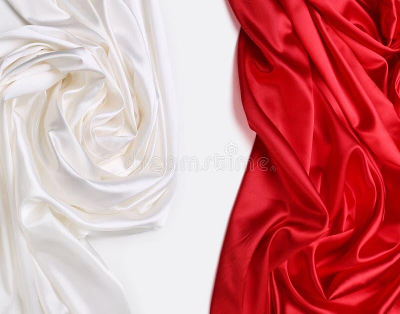 红色和空白丝织物 库存图片