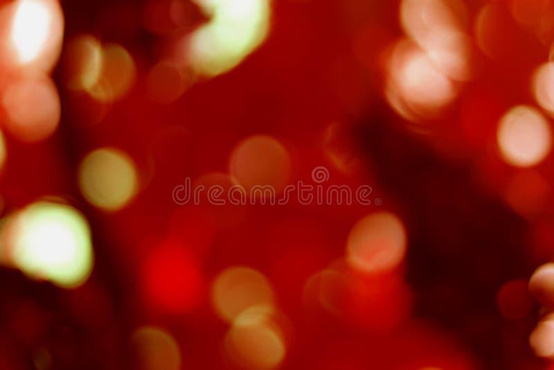 红色和金bokeh光背景,闪耀五颜六色的闪烁 库存照片