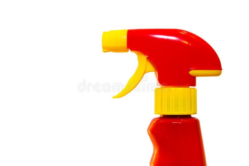 红色和黄色强烈的用于清洁产品在家的颜色塑料喷水瓶在厨房或卫生间 库存照片