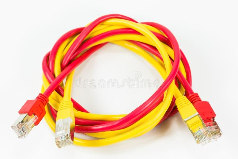 红色和黄色补丁缚住与RJ45在丝毫隔绝的连接器 库存图片