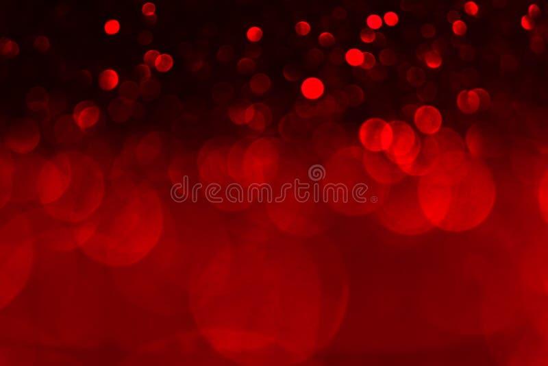 红色和黑bokeh背景 情人节红灯defocused背景 免版税库存照片