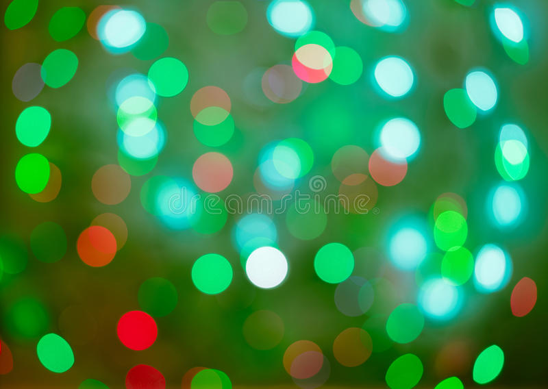 红色和绿色假日bokeh 抽象背景圣诞节 免版税库存照片
