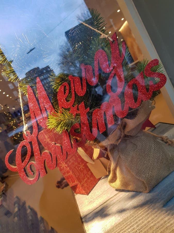 红色圣诞快乐签署装饰 免版税库存图片