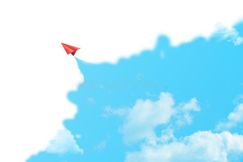 红色在天空蔚蓝的纸平面飞行围拢与白色云彩 免版税库存照片