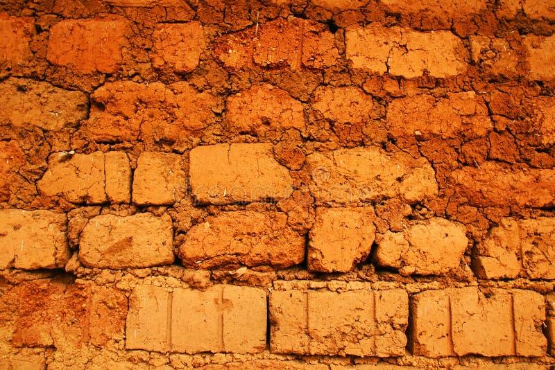 红色地球砖墙壁 免版税库存照片