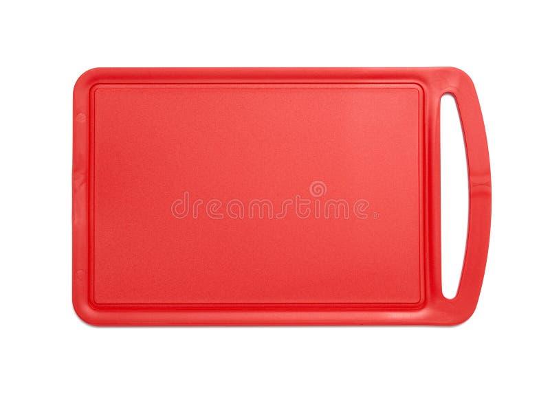 红色塑料切板 库存照片