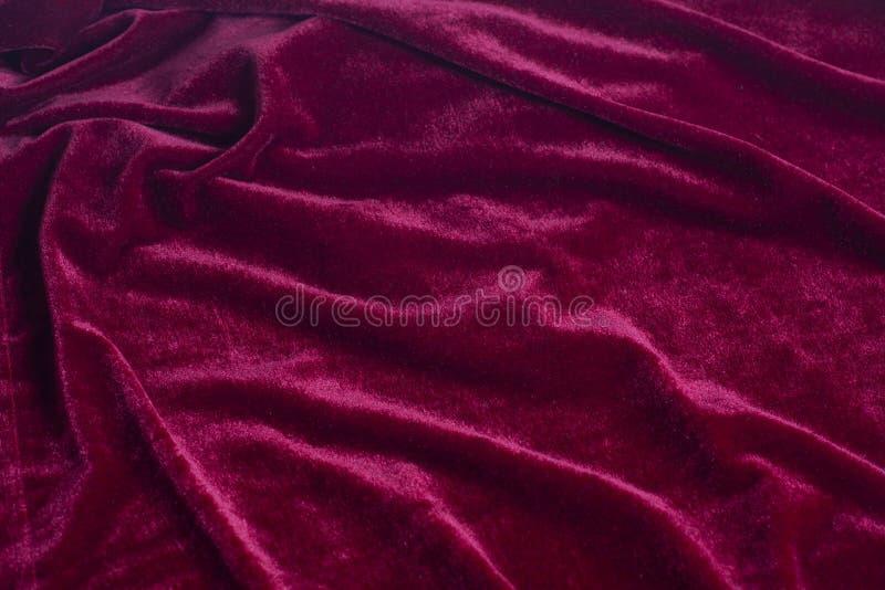 红色天鹅绒织品背景纹理 免版税库存图片