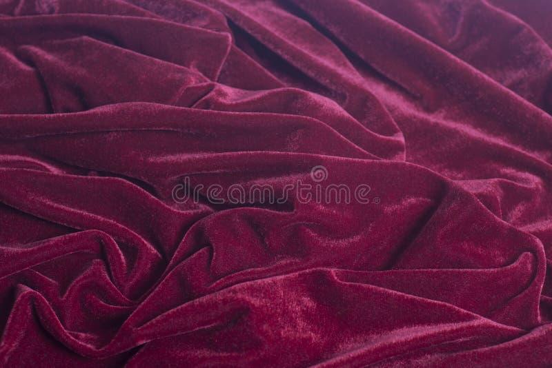 红色天鹅绒织品背景 库存图片