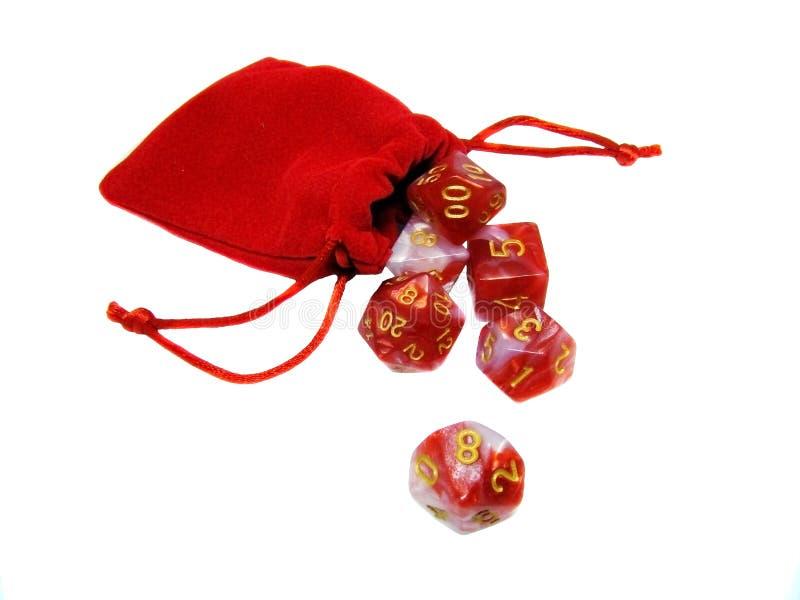 红色小袋中的红色骰子 免版税库存图片