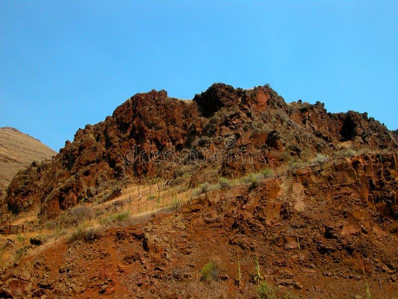 红色岩石峭壁 库存照片