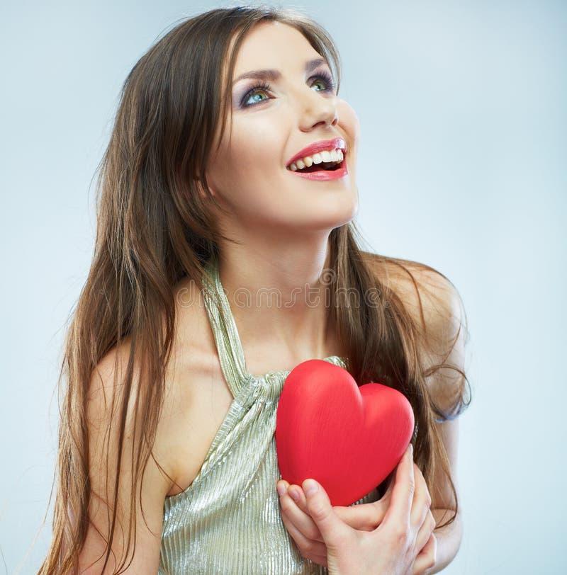 红色心脏。爱标志。美好的妇女举行Valent画象  库存照片