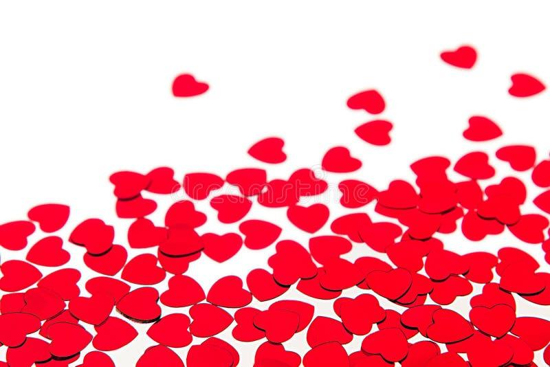 红色心脏五彩纸屑情人节边界与拷贝空间的在白色背景 库存图片
